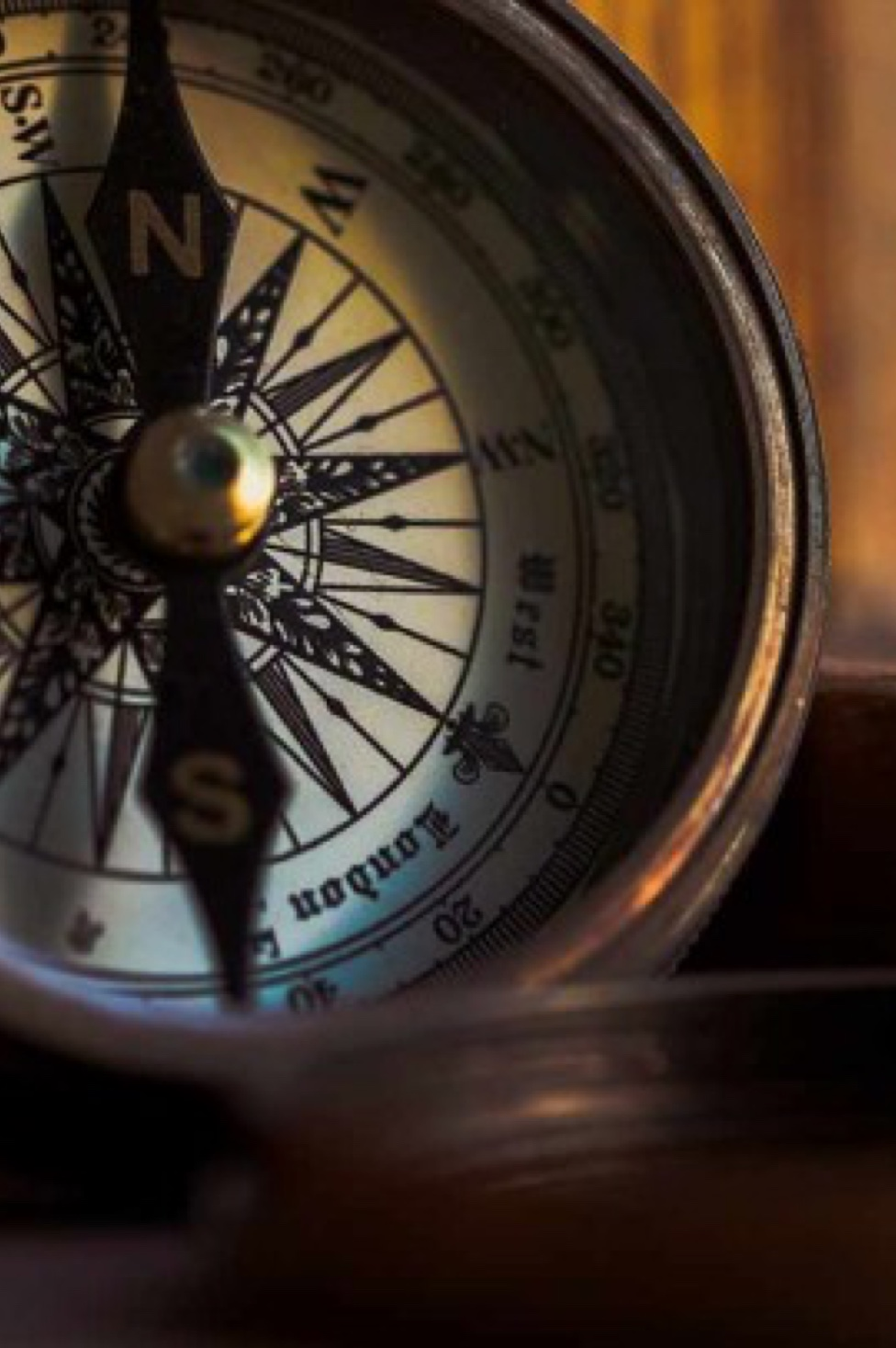 photography of a compass